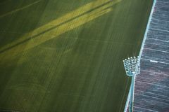 Soccer Field of a football stadium with spotlights royalty free stock photography