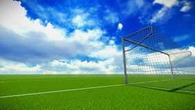 Soccer field with goal. Football field and goal in the blue sky with clouds Stock Photo