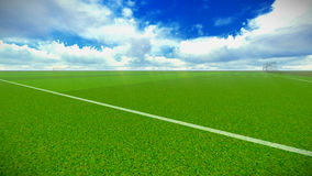 Soccer field with goal. Football field and goal in the blue sky with clouds Stock Photos