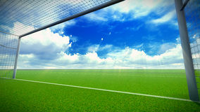 Soccer field with goal. Football field and goal in the blue sky with clouds Royalty Free Stock Photography