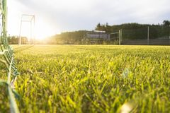 Soccer Field Goal Green Grass Outdoor Sunset. Royalty Free Stock Photography