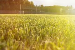 Soccer Field Goal Green Grass Outdoor Sunset. Stock Photo