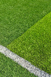 Soccer field grass. Green synthetic grass sports field with white line Royalty Free Stock Photography