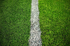 Soccer field grass. Green synthetic grass sports field with white line Stock Photos