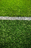 Soccer field grass. Green synthetic grass sports field with white line Royalty Free Stock Photo