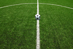 Soccer field grass with ball. Soccer ball on the field for euro 2012 news Royalty Free Stock Photo