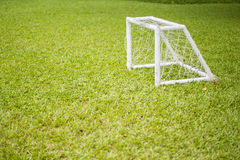 Soccer field grass Goal at the garden with white lines on grass. Goal Stock Photos