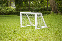 Soccer field grass Goal at the garden with white lines on grass. Goal Royalty Free Stock Image