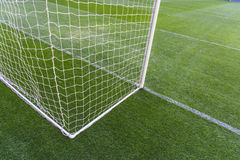 Soccer field with green grass. Football goal on stadium arena. Royalty Free Stock Photography
