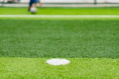 Soccer field with kids playing in far end selective focus Royalty Free Stock Photo