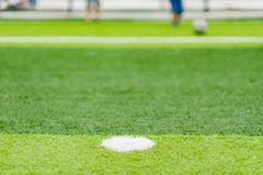Soccer field with kids playing in the far end selective focus Royalty Free Stock Photos