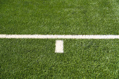Soccer Field Lines. Closeup on white soccer field lines royalty free stock images