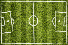 Soccer field lines on grass background. Hand drawn soccer field lines or football field lines on sunny green grass background Stock Image
