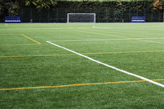 Soccer field with lines painted on the grass and goal to the bot Stock Image