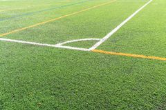 Soccer field with a new artificial turf field, white corner marking. Close up. Soccer background. Copy space royalty free stock image