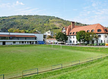 Soccer field nex to an elementary school building. Tokaj city, Hungary Stock Photo