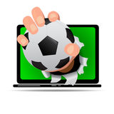 Soccer field on notbook with soccer ball in hand reflection on screen, this concept for live match score   Stock Image