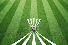 Soccer field play strategy arrows background. Conceptual soccer play abstract strategy planning with soccer ball and arrows. Soccer game copy space background Royalty Free Stock Photo