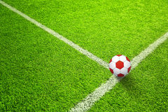 Soccer field with red ball Royalty Free Stock Photo