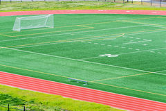 Soccer Field Running Track. Detail of soccer field with net on left and running track around field. Copy space royalty free stock photo