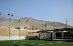 Soccer Field. Simple soccer field shot with lines, walls, and even a picture that features a mountain and blue sky Royalty Free Stock Photos