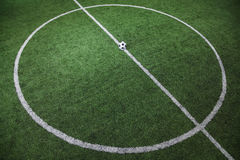 Soccer field with soccer ball on the line, high angle view Royalty Free Stock Images