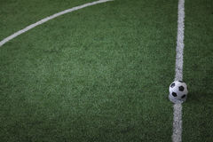 Soccer field with soccer ball on the line, high angle view Stock Photography