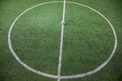 Soccer field with soccer ball on the line, high angle view Stock Photos