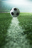 Soccer field with soccer ball and line, side view royalty free stock photos