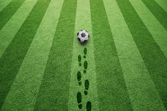 Soccer field with soccer ball and shoe prints Royalty Free Stock Images