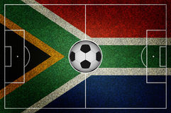 Soccer field south africa flag ball Royalty Free Stock Photos