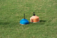 Soccer field with stack of flat marker cone Royalty Free Stock Photo
