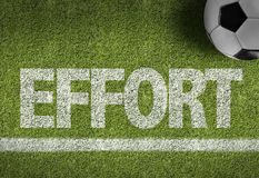 Soccer field with the text: Effort Stock Images