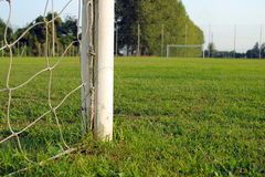 Soccer field, view from behind the goal. Green grass Royalty Free Stock Photo