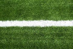 Soccer field with white lines on grass Royalty Free Stock Photography