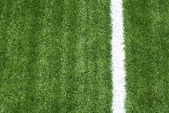 Soccer field with white lines on grass Royalty Free Stock Images
