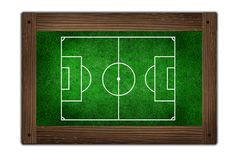 Soccer field on wooden frame Stock Images