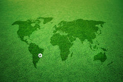 Soccer field world map sign and soccer ball Royalty Free Stock Photos