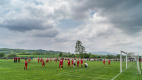Soccer field. Young soccer players warming up on the court Stock Image