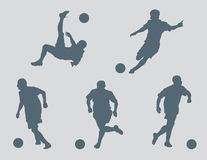 Soccer Figures Vector. Five soccer figures created in Adobe Illustrator.  These silhouettes are very detailed.  You will not be disappointed with the quality Stock Photography