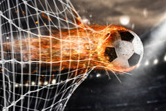 Soccer fireball scores a goal on the net Stock Photo
