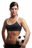 Soccer fitenss woman. A portriat of a very fit, athletic woman with a soccer ball set against a white background Royalty Free Stock Photo