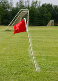 Soccer Flag and Goal. View of a corner flag and soccer goal Royalty Free Stock Image