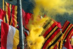 Soccer flags. Soccer fans with flags and smoke Stock Image