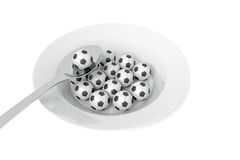 Soccer food - balls on a deep plate on a white background Royalty Free Stock Photo