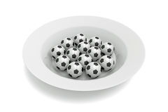Soccer food - balls on a deep plate on a white background Stock Images