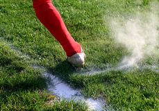Soccer foot. In dust and in action royalty free stock photos