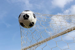 Soccer foot ball in goal net Stock Image