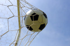 Soccer foot ball in goal net Royalty Free Stock Photos