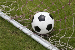 Soccer foot ball in goal net Royalty Free Stock Image